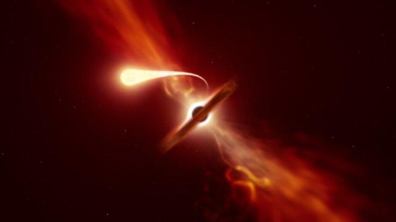 """Représentation d'une """"spaghettification"""" d'une étoile par un trou noir."""