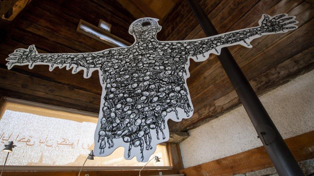 Oeuvre impressionnante d'Hani Abbas, où la silhouette qui hurle sa douleur est constituée d'une infinité de personnages représentant les victimes de la guerre.