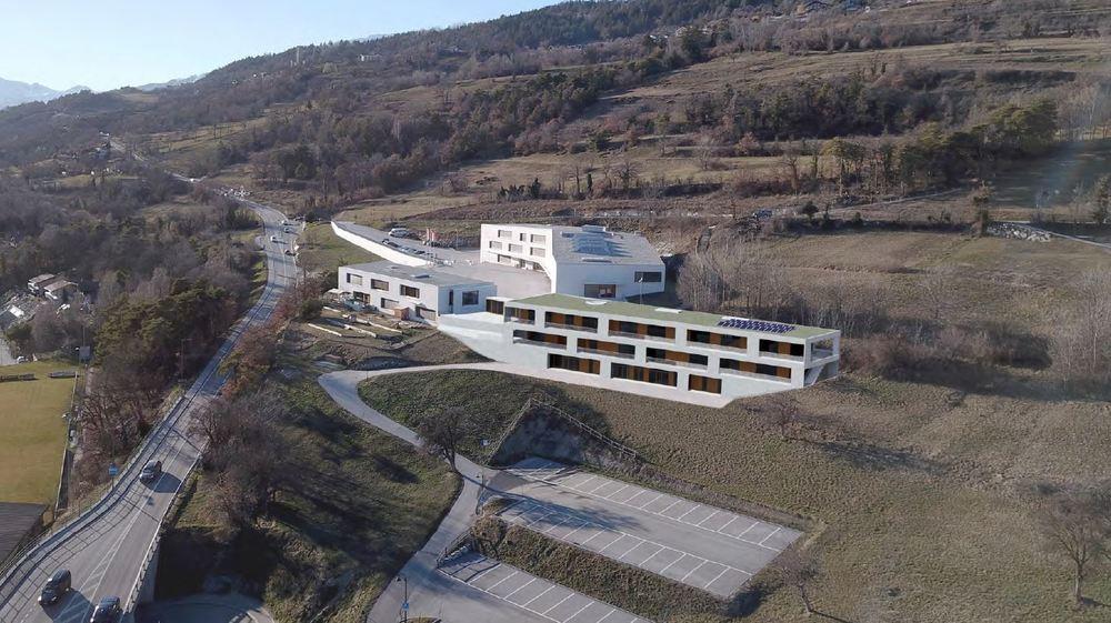 Cette image de synthèse donne un aperçu du futur bâtiment de la crèche-UAPE de Martelles, qui se situera juste en dessus des parkings sud du complexe.