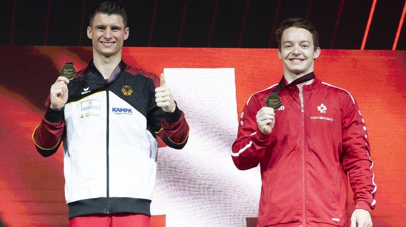 Crédité de 15,100 points, Christian Baumann (à droite) partage la troisième place avec l'Allemand Lukas Dauser.