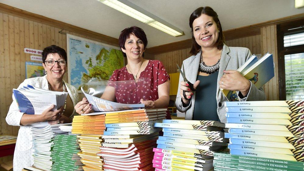 Epaulées par des parents d'élèves et des bibliothécaires, Myriam Broyon, Myriam Erné et Angélique Rey (de gauche à droite) ont doublé 2800 livres en deux soirs.