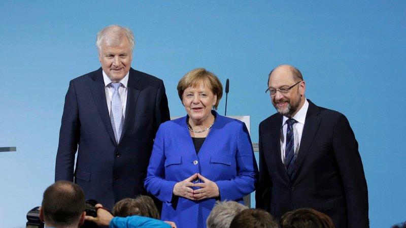 Horst Seehofer (à gauche, CSU), Angela Merkel (CDU) et Martin Schulz (SPD) ont présenté, hier, un accord de principe entre leurs trois partis,  détaillant ce à quoi pourrait ressembler le programme d'une nouvelle «grande coalition».