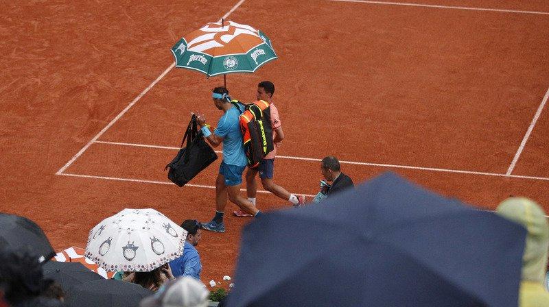 Tennis - Roland-Garros: Djokovic s'impose, Nadal est interrompu par la pluie
