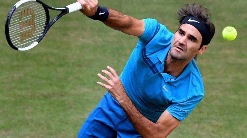 Tennis: Federer bat laborieusement Benoît Paire et passe en quarts au tournoi de Halle