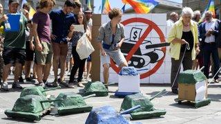 L'initiative pour une interdiction du financement des producteurs de matériel de guerre a abouti