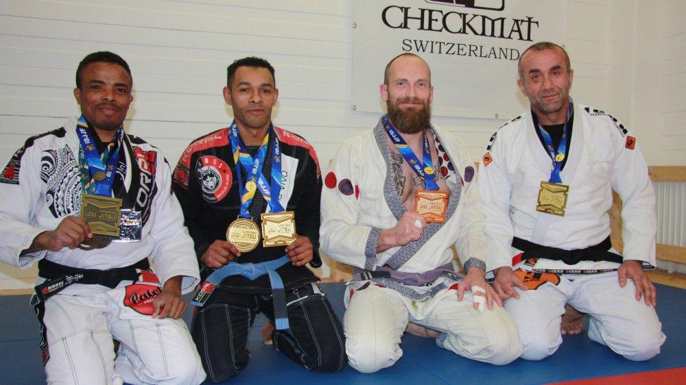 Quatre des cinq médaillés valaisans: Edvaldo Da Mota, Helio Fernandes, Thierry Jordan et Hafiz Kucevic.