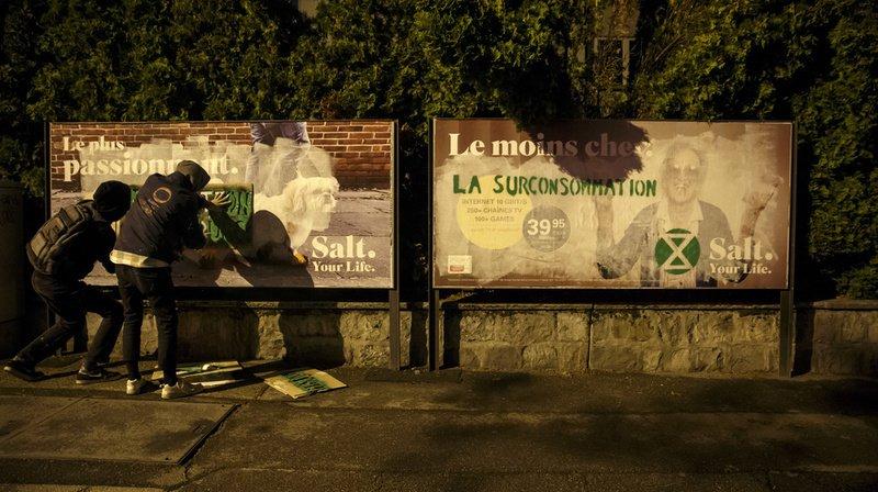 Genève: des dizaines de pubs détournées pour alerter sur l'urgence climatique