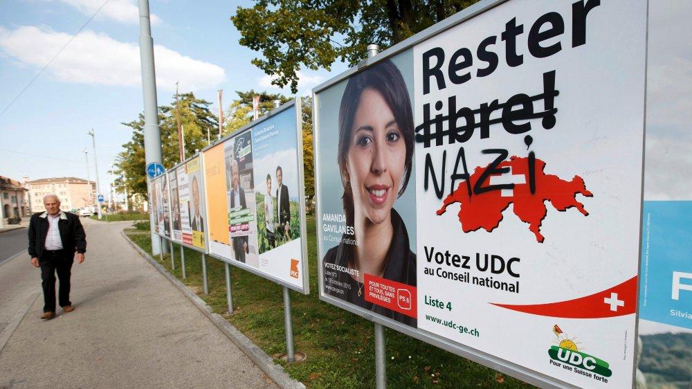 Selon Oskar Freysinger, chef de campagne romand de l'UDC, «si une affiche n'est pas provocatrice, c'est une publicité pour un dentifrice». D'où des modifications apportées à la main...