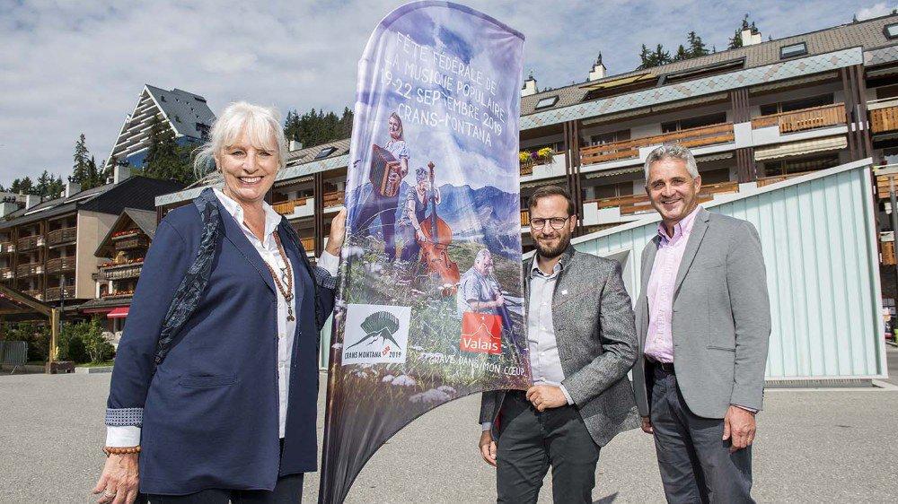 Ursula Haller, présidente de l'Association suisse de la musique populaire, Alessandro Marcolin, responsable marketing de Valais/Wallis Promotion, et Bruno Huggler, directeur du comité d'organisation, préparent ardemment la 13e Fête fédérale de la musique populaire.