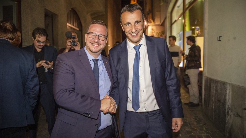 Sidney Kamerzin (à droite) avec le PDC du Haut-Valais Philipp-Matthias Bregy, au soir des élections, dimanche 20 octobre.