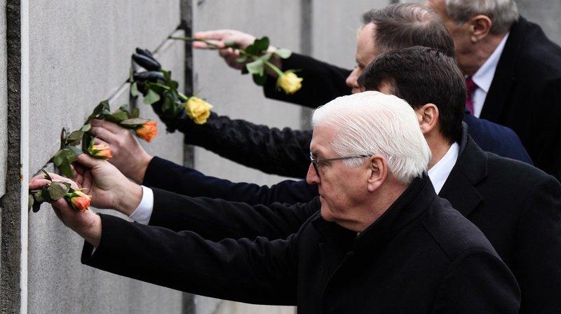 Le président allemand Frank-Walter Steinmeier, ici en train de commémorer la chute du Mur de Berlin, ne s'est pas privé pour critiquer la politique de Donald Trump, qui lui construit un mur entre son pays et le Mexique.