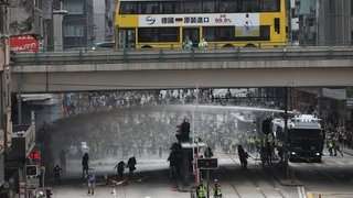 Des opposants défient Pékin par milliers