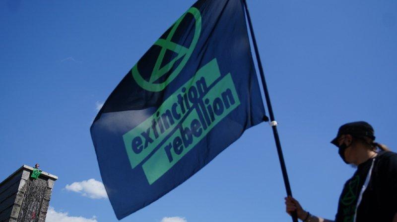 Climat: action symbolique de 150 activistes d'Extinction Rebellion à Berne